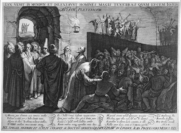 En la Caverna de Platón hay dos grupos de filósofos que están separados por un muro, pero en un acalorado debate.