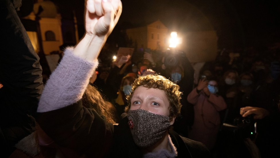 A demonstrator gestures during a protest in Poznan, Poland, 23 October, 2020.