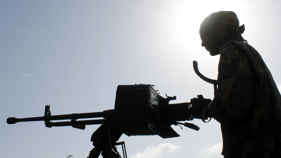 File photo: A Somali soldier holds a machine gun during a patrol in the streets of Merka, 90kms north of Mogadishu, on September 2, 2012.