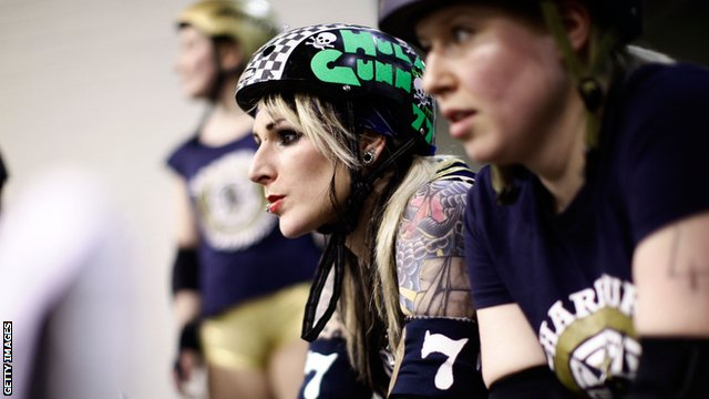 Roller Derby player watching from sidelines