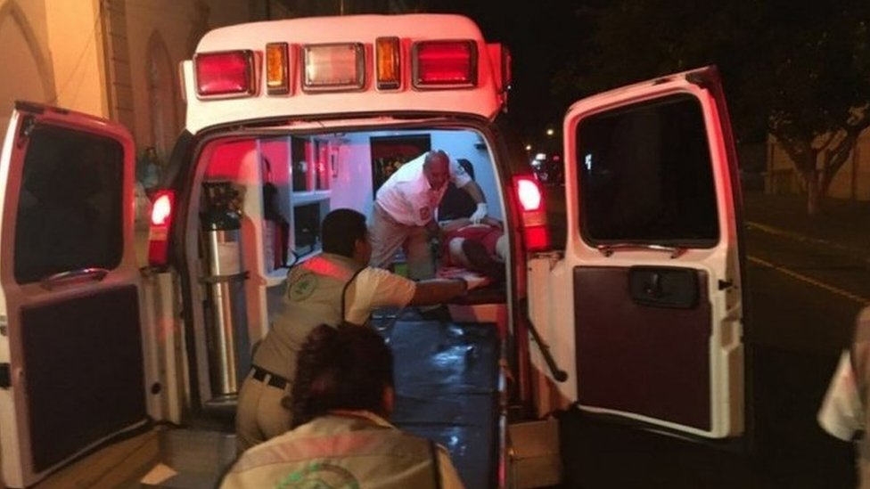 Paramedics treat a victim after a shooting in a rehabilitation center in Chihuahua, Mexico, 27 September 2017.