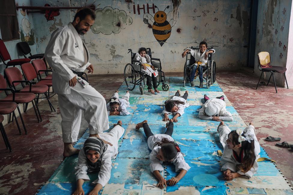 Children in a karate lesson