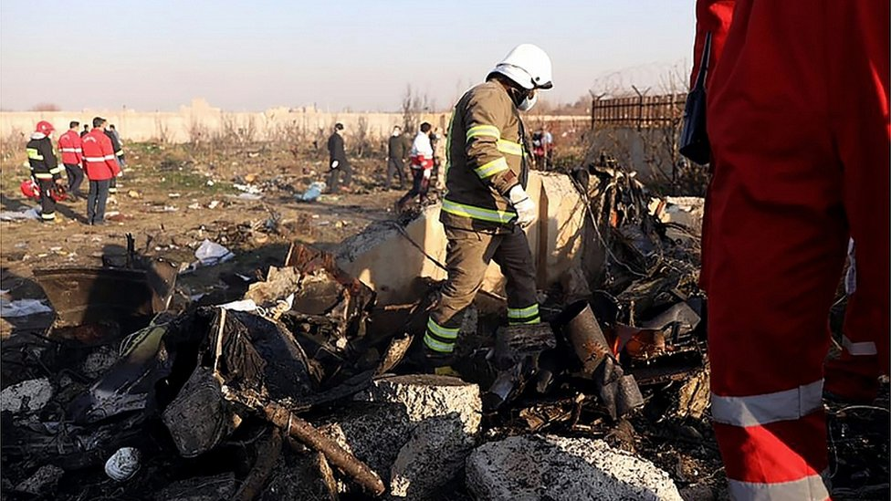 Rescue teams are pictured amid the wreckage after a Ukrainian plane carrying 176 passengers crashed near Imam Khomeini airport in the Iranian capital Tehran early in the morning on January 8, 2020