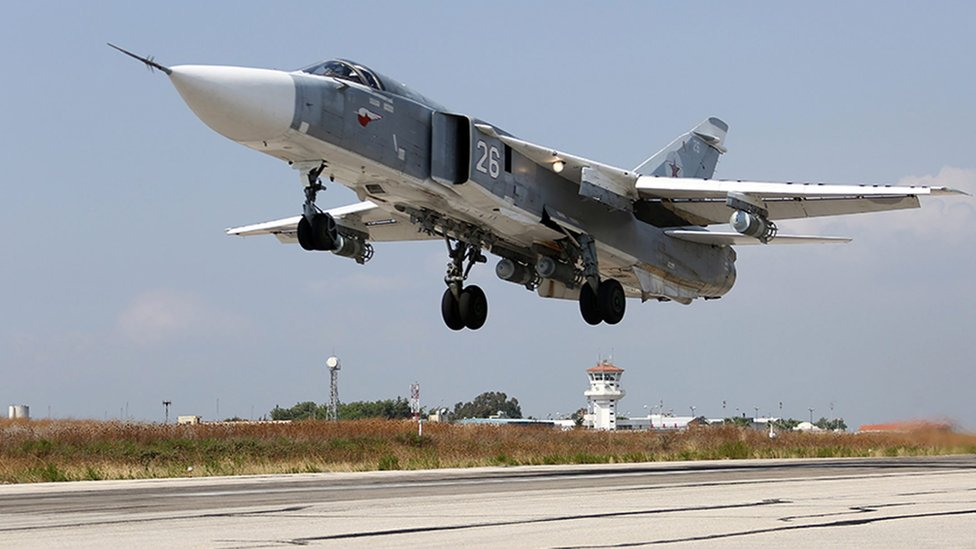 A handout picture dated 3 October 2015 from the Russian defence ministry shows a Russian SU-24 taking off from the Humaymim airbase, outside Latakia, Syria