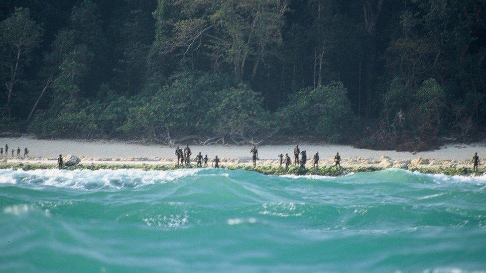 The Sentinelese stand guard on an island beach in 2005