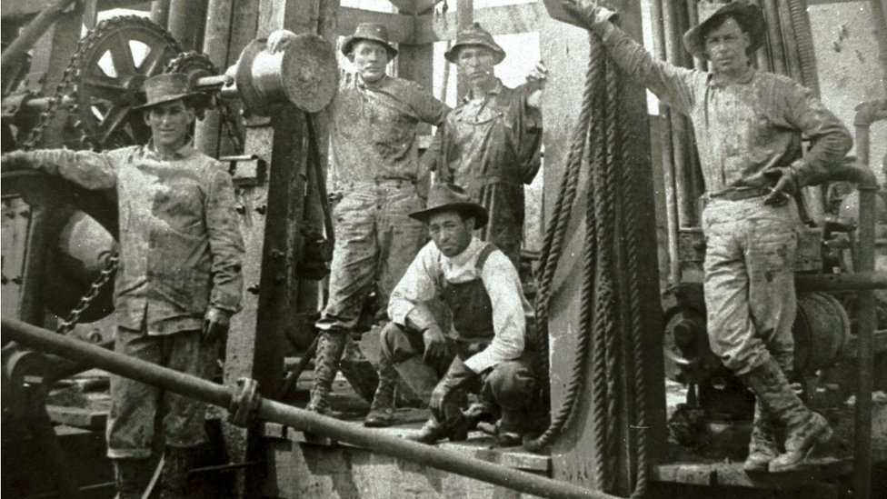 A drilling crew poses for a photograph at Spindletop Hill in Beaumont, Texas where the first Texas oil gusher was discovered in 1901.