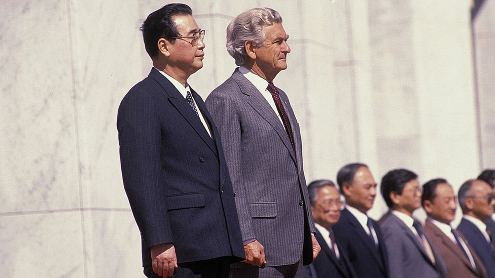 Bob Hawke stands with Chinese Premier Li Peng in 1988 at a formal ceremony in Western Australia