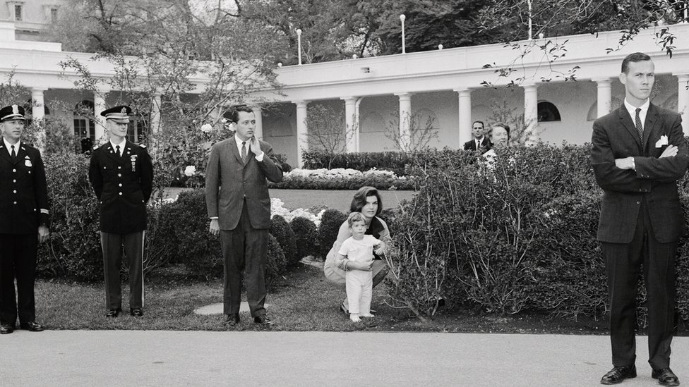 Jacqueline Bouvier Kennedy and her son John Jr in the south grounds of the White House in 1962