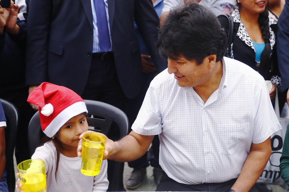 Exiled former president of Bolivia Evo Morales talks to a girl during a Christmas breakfast with members of the Bolivian community of Buenos Aires at Campo De Deportes del Colegio Nacional de Buenos Aires on 25 December 2019 in Buenos Aires, Argentina