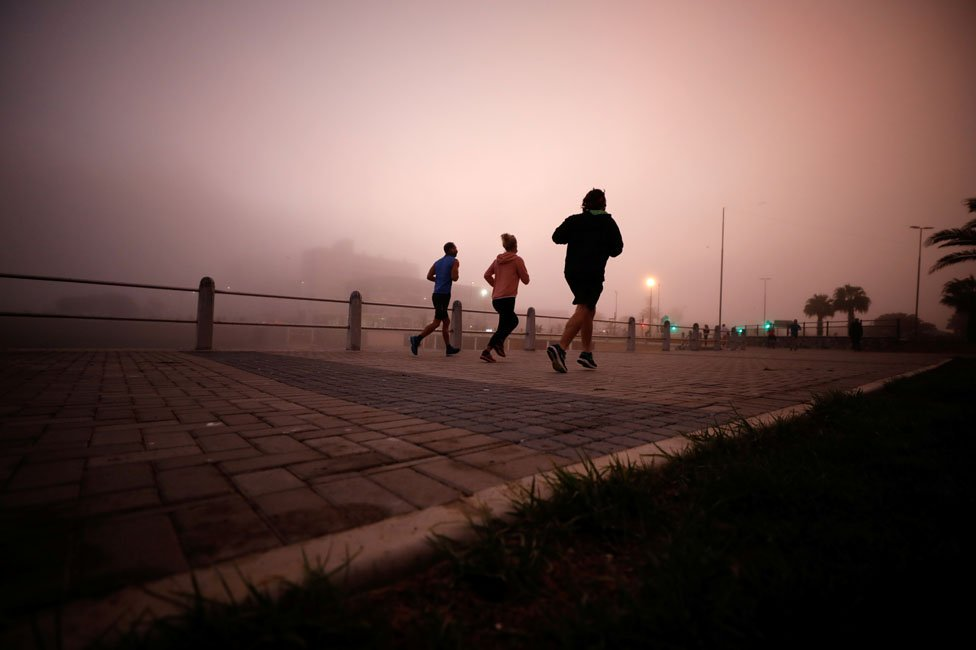 Joggers in the mist