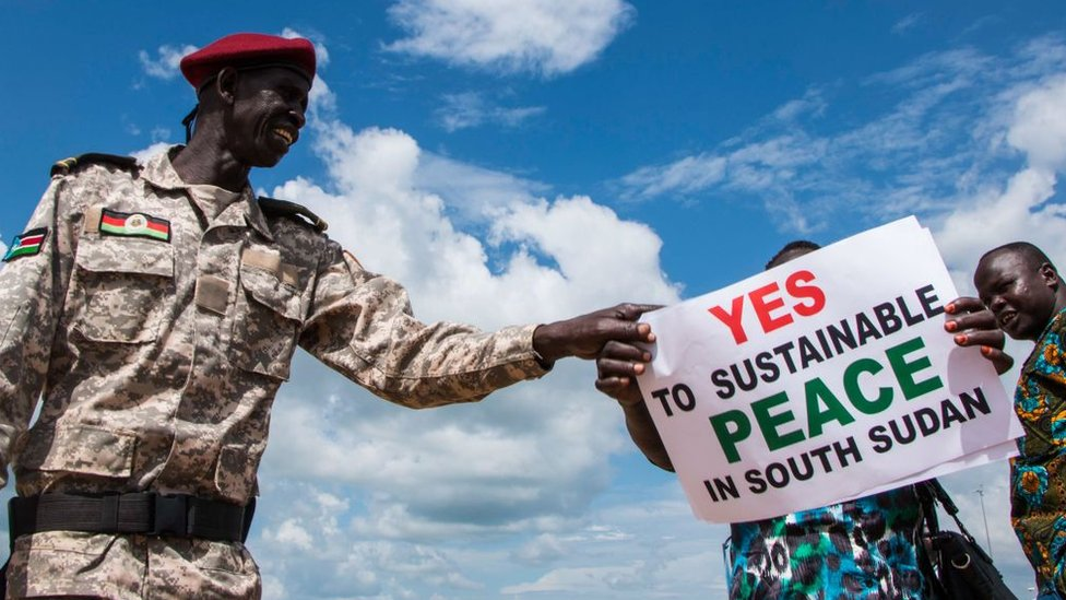 South Sudanese wait for the arrival of South Sudan's President at Juba International Airport in Juba on June 22, 2018