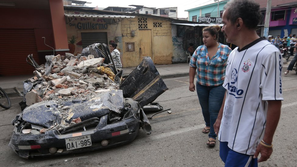 A car destroyed by rubble in Ecuador's earthquake