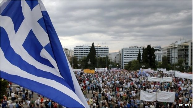 Greek flag and protesters