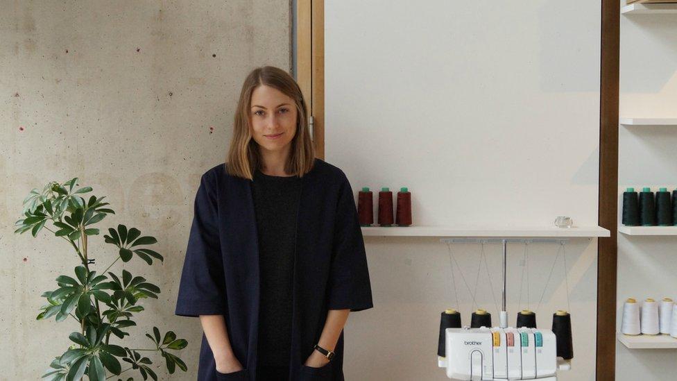Aimee Harrison standing in her studio