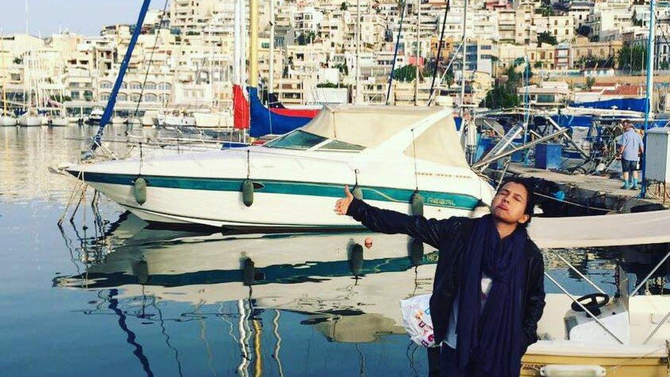 Huma Mobin at the harbour in Santorini