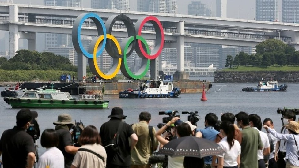 Olympic rings being moved