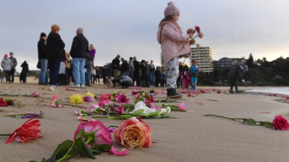 Friends held a vigil at Sydney's Freshwater beach on Wednesday morning