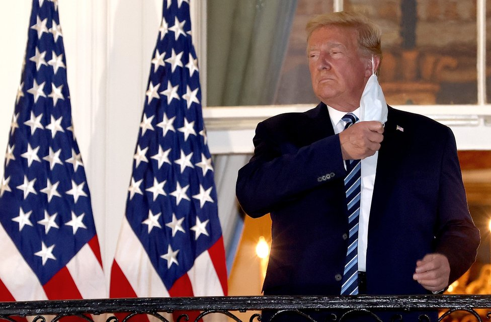 Donald Trump removes his mask upon return to the White House from Walter Reed National Military Medical Center on 5 October 2020