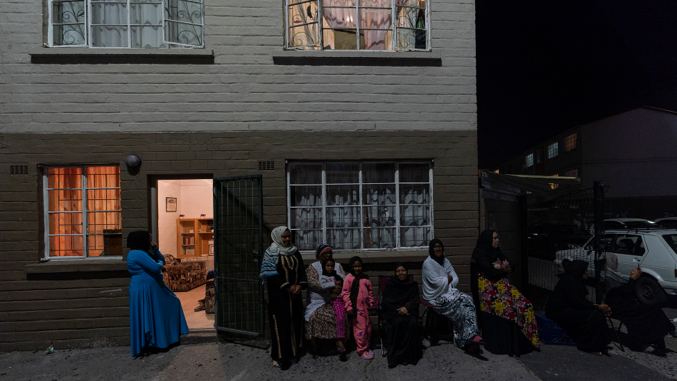 People gathered outside their flats in Manenberg, Cape Town - South Africa