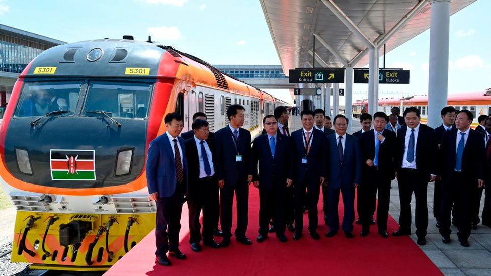 Chinese officials pose for a photo at the launch of the Standard Gauge Railway (SGR) passenger train from Nairobi to Suswa in October 2019
