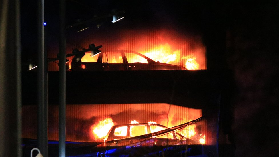 Cars on fire in the car park