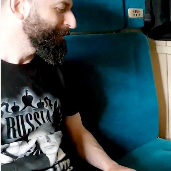Nazarro wearing black T-shirt featuring Putin