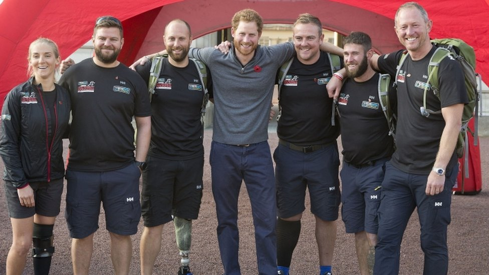 Prince Harry welcomes 'walking wounded' after 1,000-mile trek - BBC News