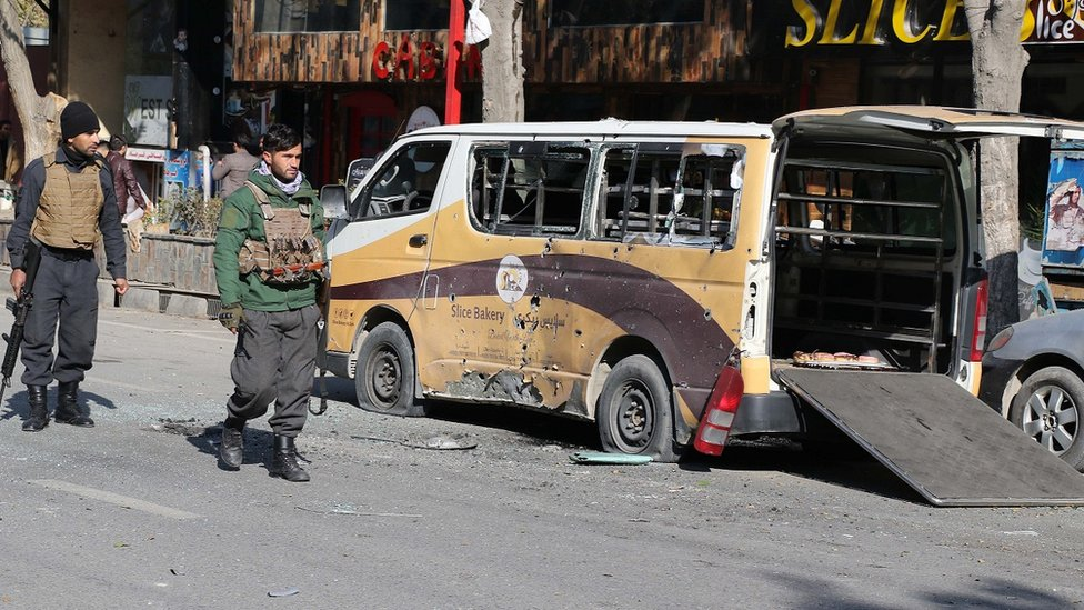 Afghan security officials inspect the scene of magnetic bomb blasts and rocket attacks in Kabul, Afghanistan on November 21, 2020.