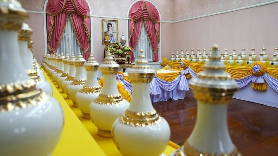 A picture of Thailand's King Maha Vajiralongkorn is seen among ewers containing sacred water for his upcoming coronation ceremony at the Interior Ministry in Bangkok, Thailand, April 10, 2019.