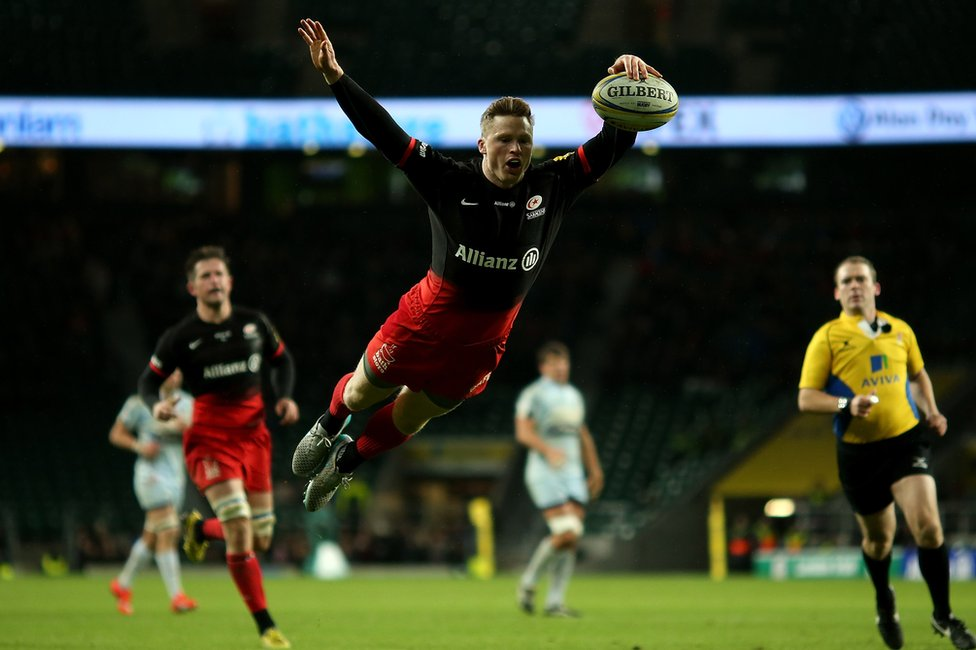 Chris Ashton of Saracens rugby team scores a try
