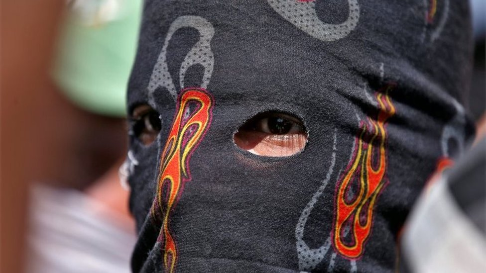 A masked protester attends a protest in Srinagar, against the recent killings in Kashmir September 18, 2016