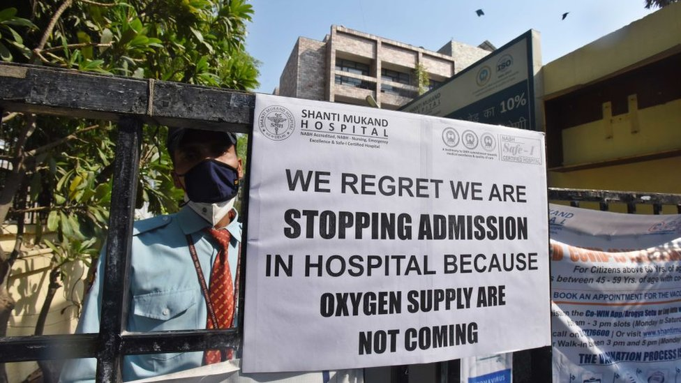 A public notice hangs outside Shanti Mukund Hospital notifying shortage of oxygen beds, on April 22, 2021 in New Delhi, India.