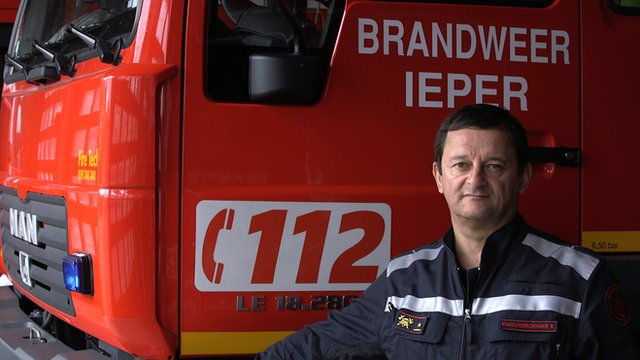 Fire chief Rik Vandekerckhove in front of a fire engine