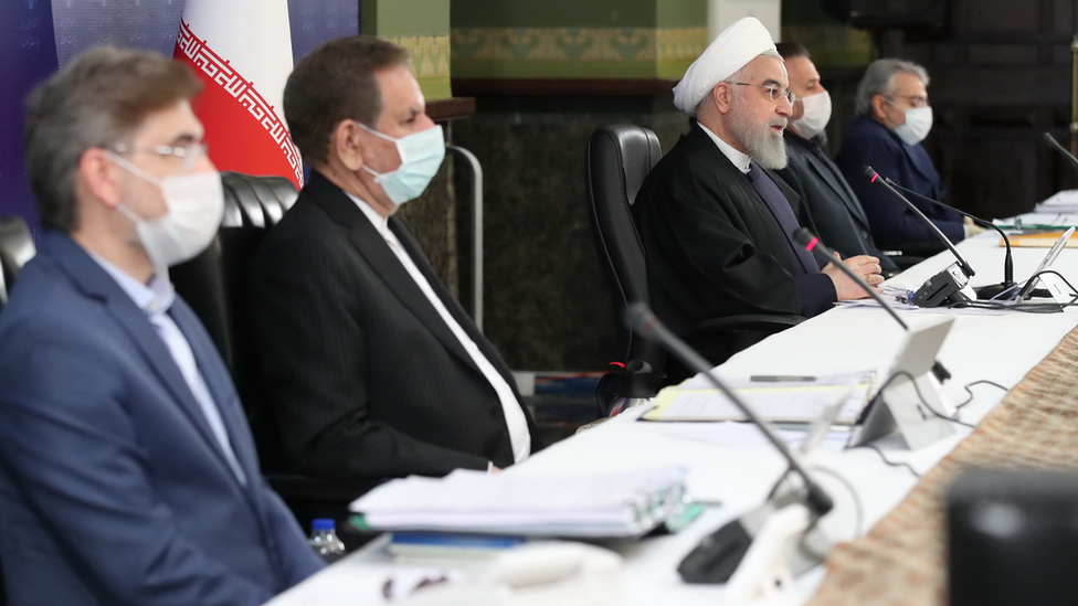 Iranian officials, including President Hassan Rouhani, meet to discuss the coronavirus pandemic