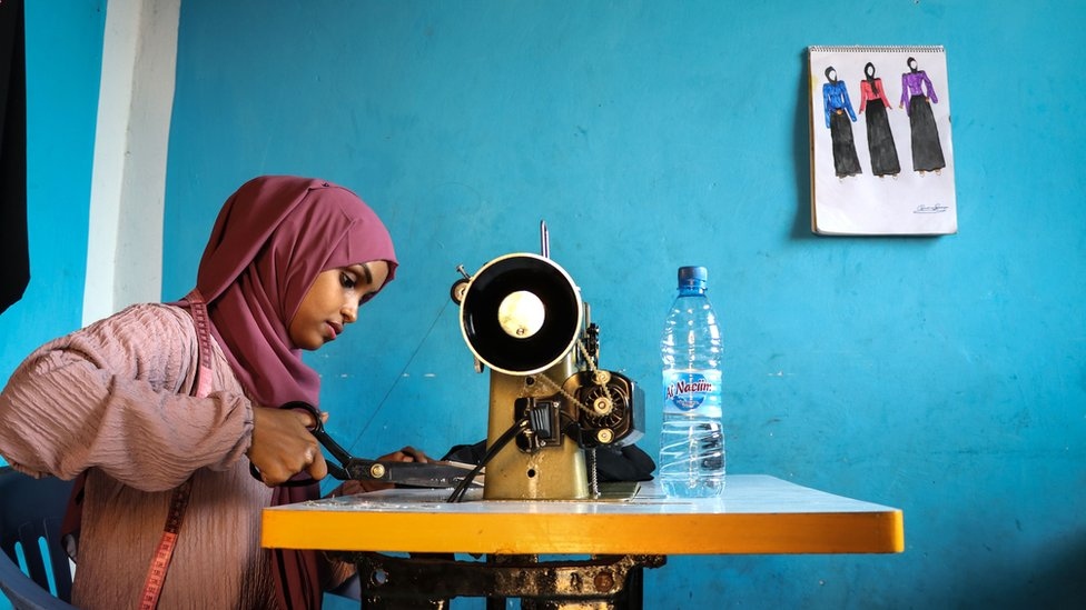 Woman sews.