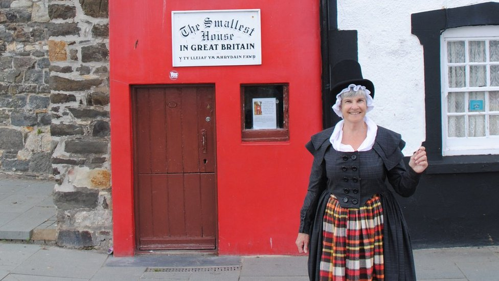Amanda Whitehead outside the UK's smallest house, on the quayside at Conwy