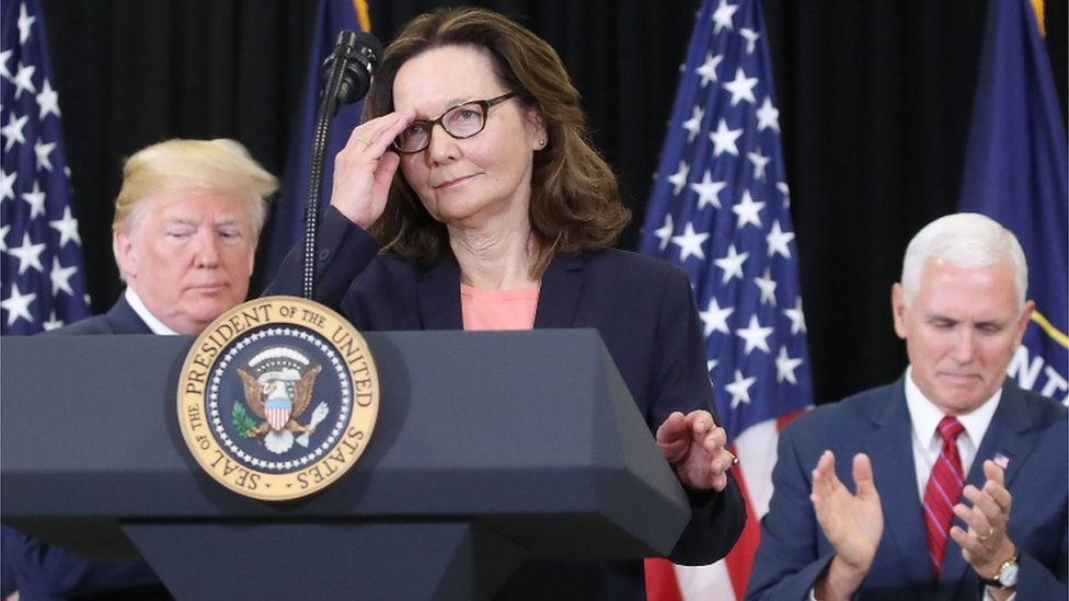 Gina Haspel prepares to give a speech after her swearing-in, flanked by US President Donald Trump and Vice President Mike Pence