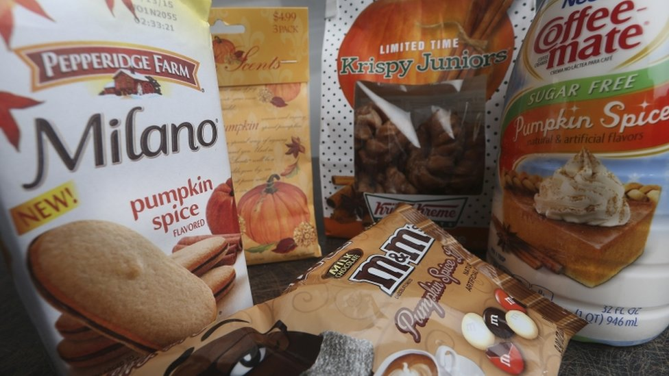 Pumpkin spice products ranging from cookies and donuts to candy and air freshener are shown in Atlanta