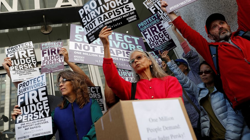 Activists hold signs calling for the removal of Judge Aaron Persky from the bench after his controversial sentencing in the Stanford rape case, in San Francisco, California, on 10 June