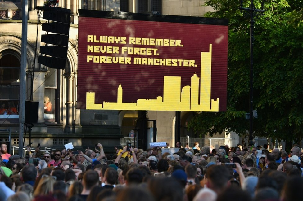 Sign reading 'Always Remember, Never Forget, Forever Manchester'