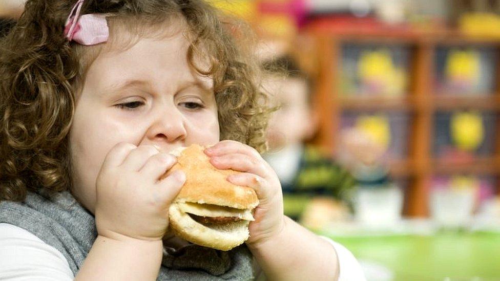 Child eats hamburger