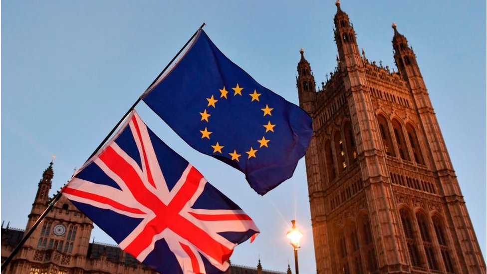 UK and EU flags at the Houses of Parliament