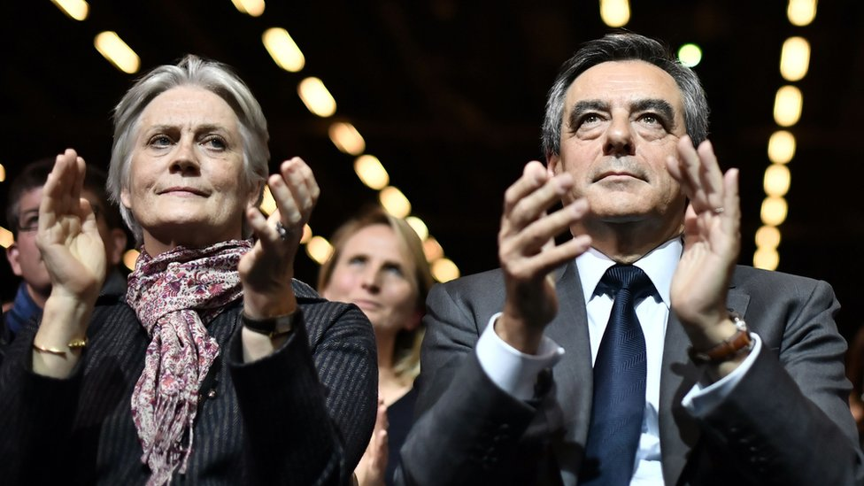 File image taken on 25 November 2016 shows Francois Fillon (R), candidate for the right-wing primaries ahead of the French 2017 presidential election, with his wife Penelope attending a campaign rally in Paris, ahead of the primary's second round on