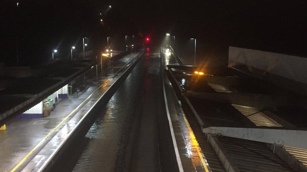 Flooding closes railway line at Dawlish sea wall