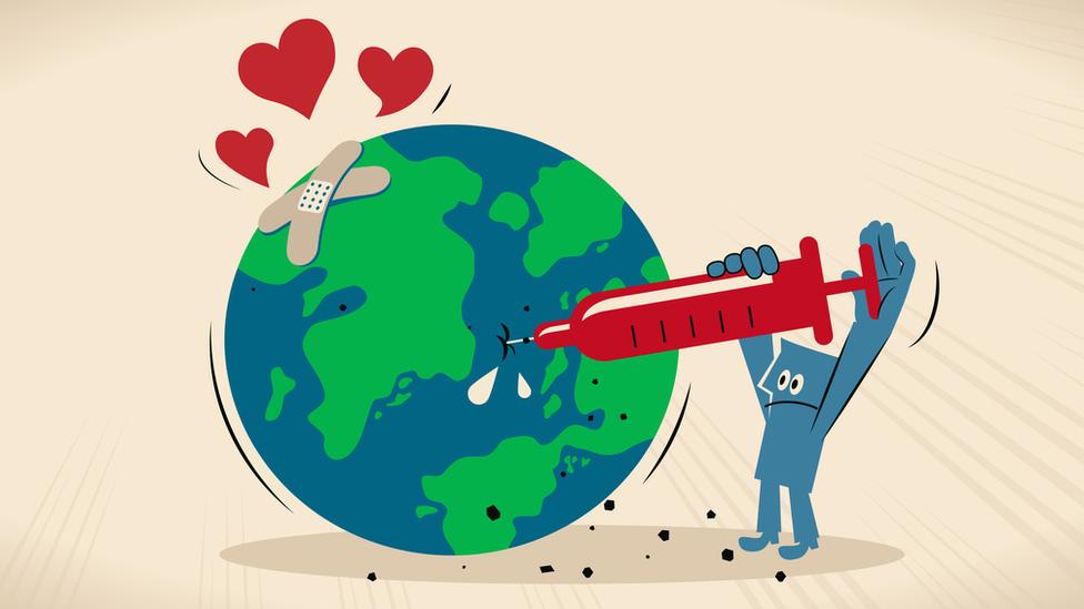 رسم توضيحي يظهر شخصاً يحقن كوكب الأرض بجرعة من الحب