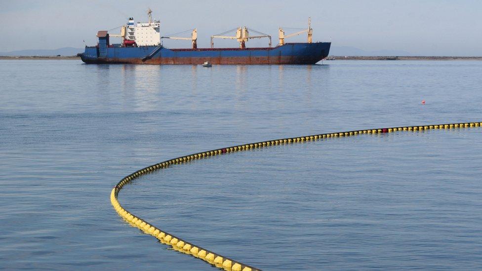 Oil spill boom in response to tanker leak