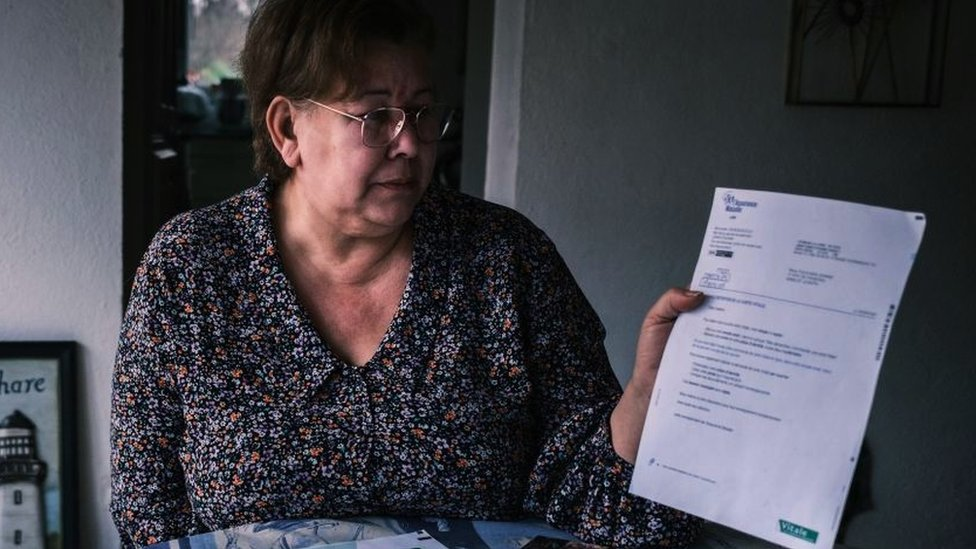Jeanne Pouchain looks at letter telling her she's legally dead