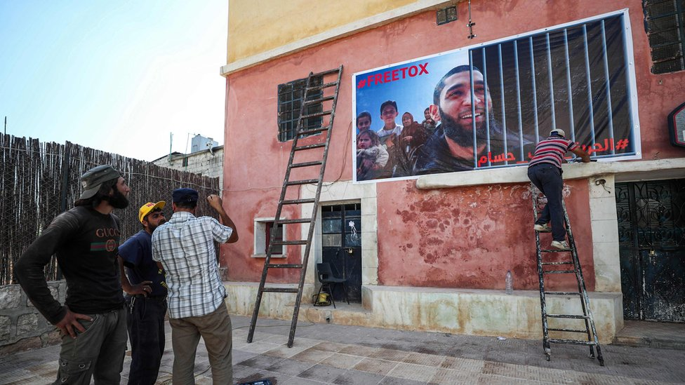 A poster calling for Tauqir Sharif's is placed on a wall in Atmeh, Syria (1 July 2020)