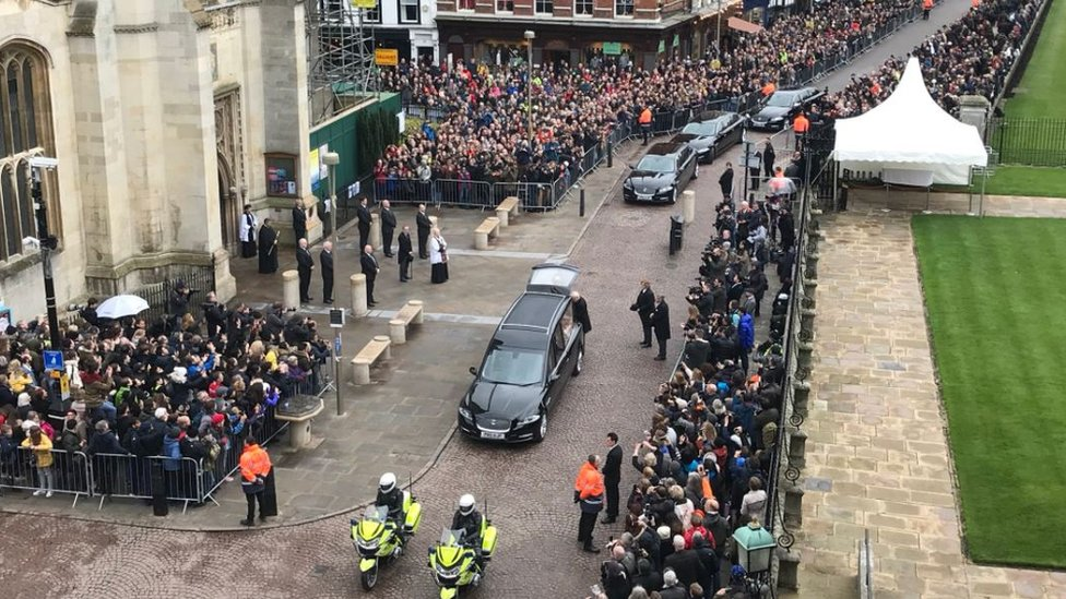 Aerial view of hearse arriving at Great St Mary's Church in Cambridge