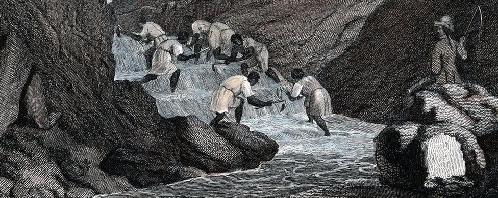 'Manner of Washing for Gold in the Brazilian Mountains', 1814. Negro slaves washing for alluvial gold watched over by a slave master brandishing a whip.